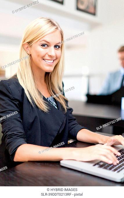 Businesswoman working on laptop