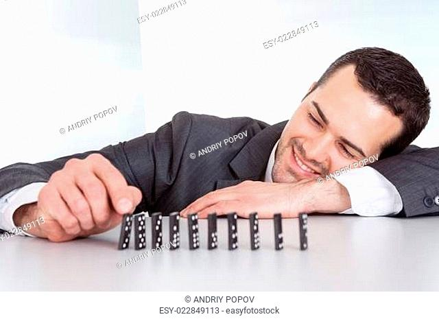 Businessman playing domino