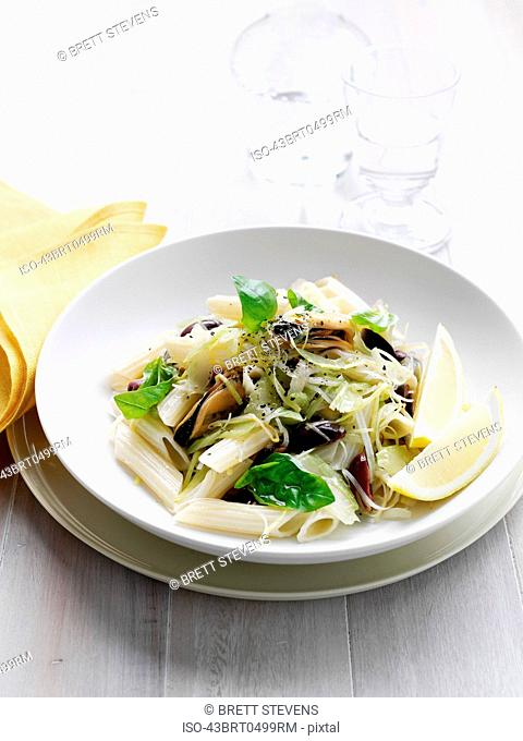 Bowl of pasta with olives and cheese