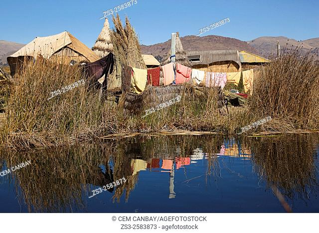 Loundry hanging to dry outside of a Aymara Totora house on an island, Uros Islands, Lake Titicaca, Puno Region, Peru, South America