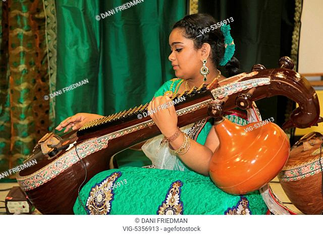 CANADA, BRAMPTON, 03.08.2015, Tamil Hindu girl playing the veena performs a classical South Indian devotional song during the inauguration of the Sri...
