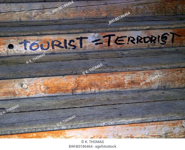 screen of boards with inscription tourist like terrorist, Switzerland, Lausanne, Waadt