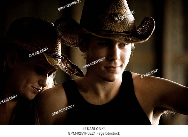 Close up of young couple wearing cowboy hat