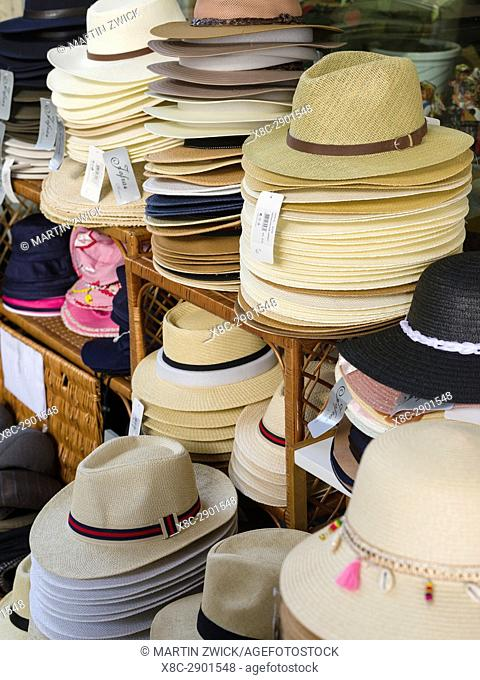 Selling of typical hats made of straw. Aveiro in Portugal on the coast of the Atlantic. Because of the many channels Aveiro is called the venice of Portugal