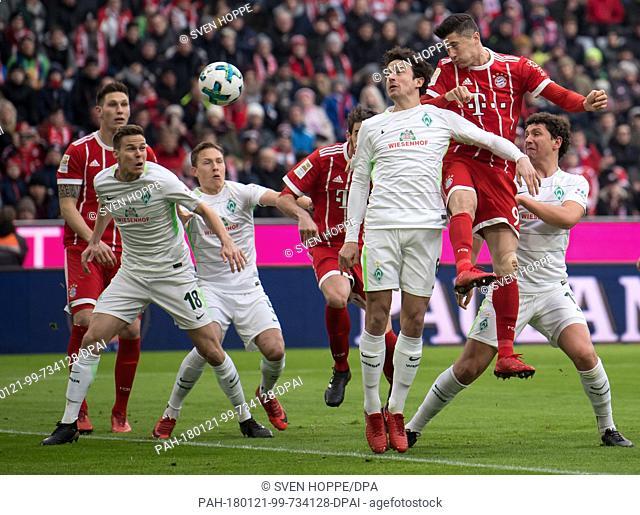 Bayern Munich's Robert Lewandowski (R) heading the ball towards Bremen's goal while Bremen's Niklas Moisander (2nd from left) and Thomas Delaney (2nd from...