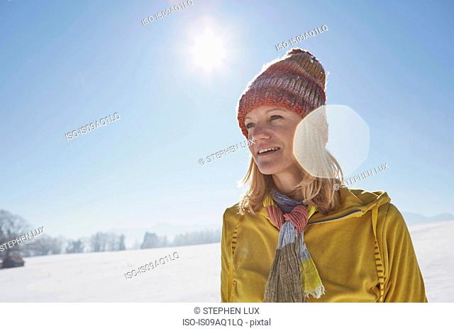 Mature woman in snowy landscape
