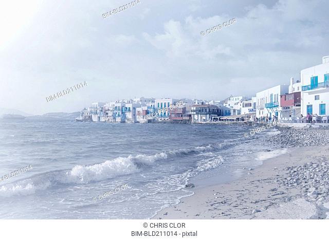 Waves washing up on beach, Mykonos, Greece