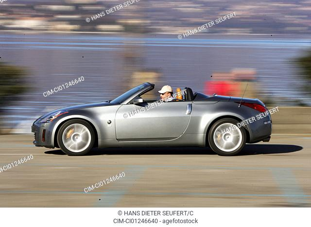 Car, Nissan 350 Z Roadster, model year 2003-, silver, Convertible, open top, driving, side view, country road