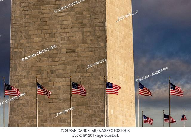 Washington Monument And USA Flags - Close view of the lower section of the Washington Monument with the United States of America flags surrounding the monument