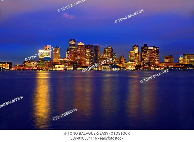 Boston skyline at sunset and river reflection in Massachusetts USA