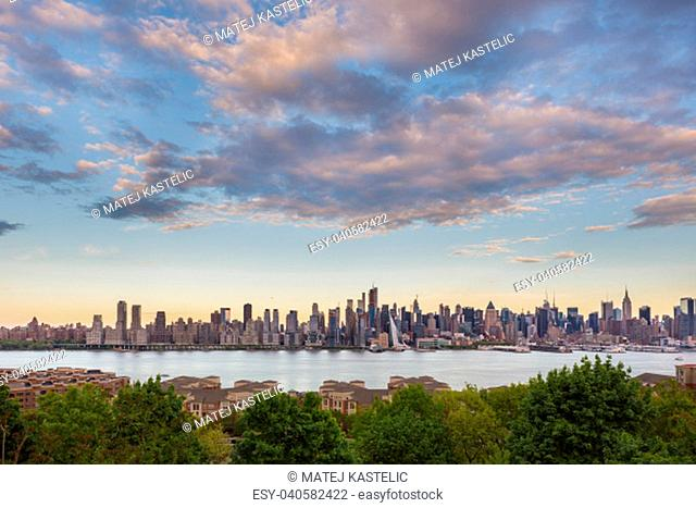 New York City midtown Manhattan sunset skyline panorama view from Boulevard East Old Glory Park over Hudson River