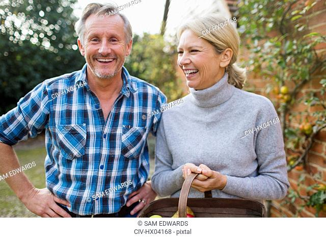Portrait happy, carefree mature couple in garden