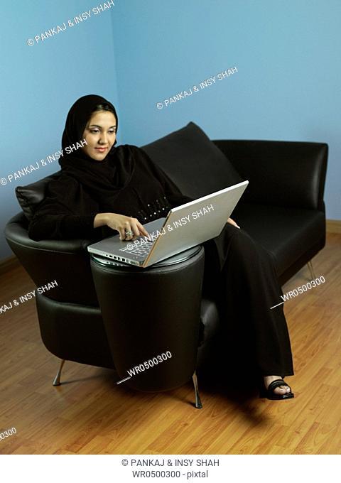 Arab lady working on laptop