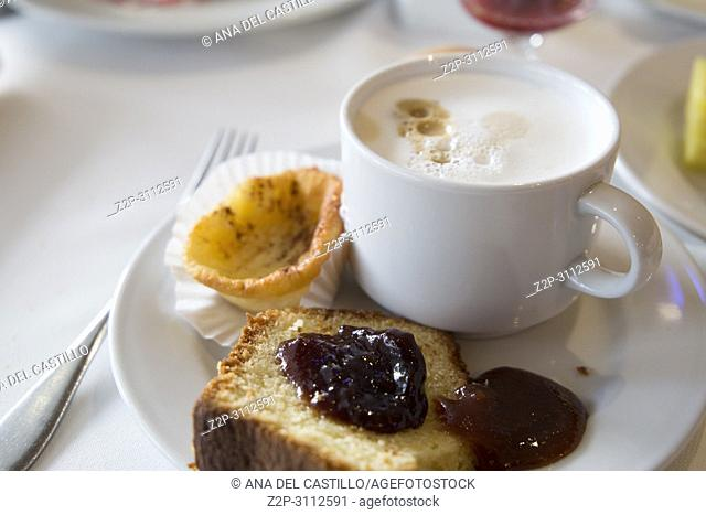 Sponge cake with coffee with milk and jam
