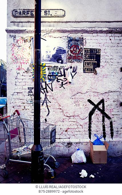 Graffiti on wall and lamppost. Parfett Street, East End, London, England