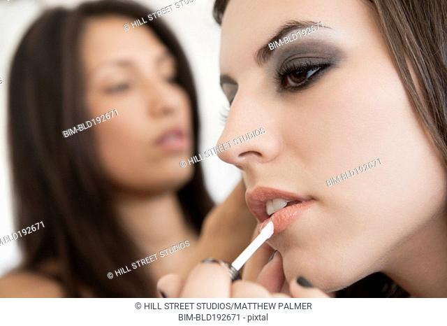 Hispanic models preparing for fashion show