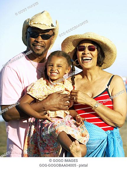 African family smiling on the beach