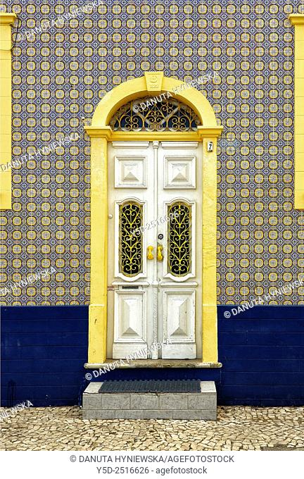Europe, Portugal, Algarve, Faro district, Lagoa, Ferragudo, front of townhouse covered with traditional azulejos