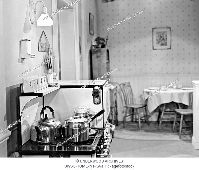 United States: c. 1930.A kitchen with several pots on the stove top