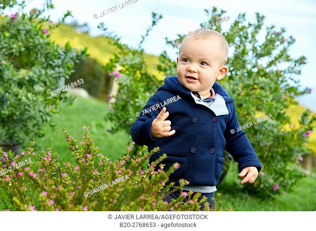 Baby, Child in the garden, Gipuzkoa, Basque Country, Spain