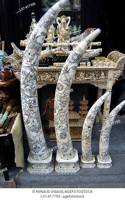 Carved elephant tusks at the Panjiayuan Market. Beijing. China