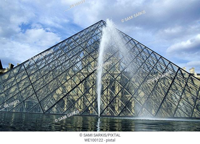 Water fountain in front of the Louvre Pyramid, Paris, France