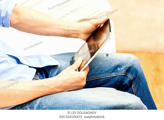 technology, people and lifestyle, distance learning concept - close up of man working with tablet pc computer at home