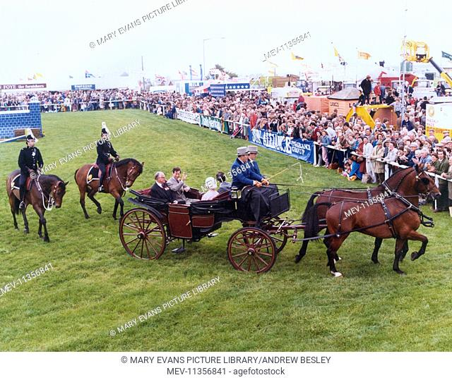 Prince Charles in an open horse-drawn carriage with Lord and Lady Falmouth, arriving at the Royal Cornwall Agricultural Show