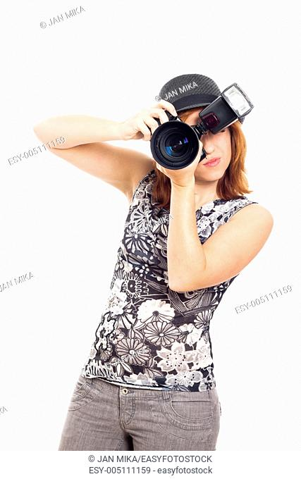 Portrait of young female photographer, isolated on white background