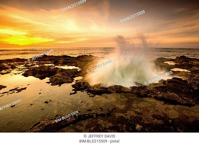 Ocean waves crashing in Thor's Well at sunset, Cape Perpetua, Oregon, United States