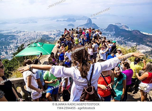 Masses of tourists on the platform at Christ the Redeemer statue on Corcovado mountain, Rio de Janeiro, Brazil