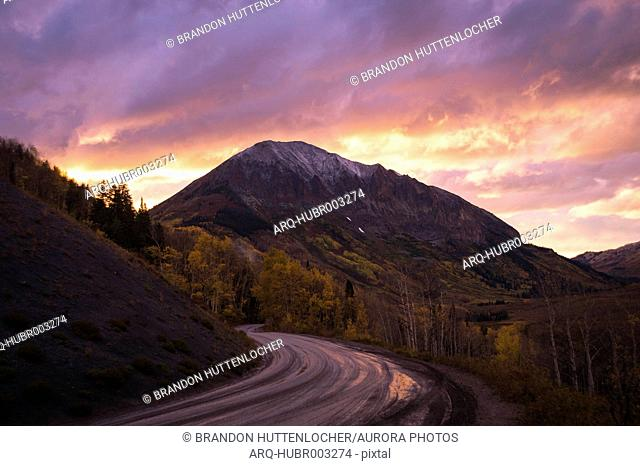 Dirt mountain road at sunset, Crested Butte, Colorado, USA