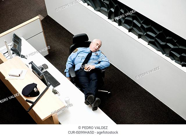 Security guard sleeping at desk