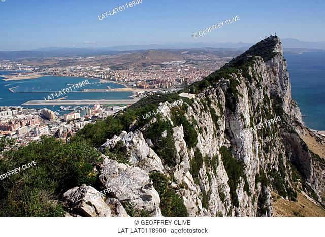 The Top of the Rock. Gibraltar town is a British overseas territory,at the base of a huge rock,The Rock of Gibraltar,on the Iberian peninsula