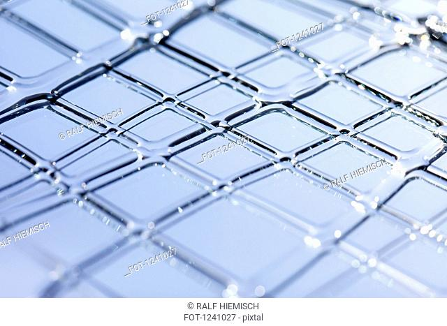 Detail of a grid structure made out of a liquid substance