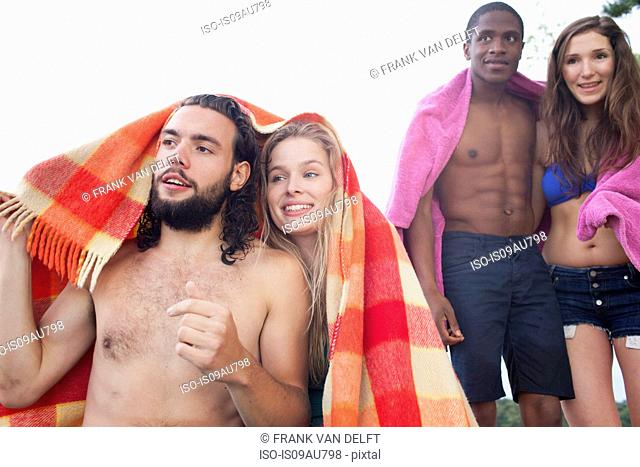 Couples relaxing on beach