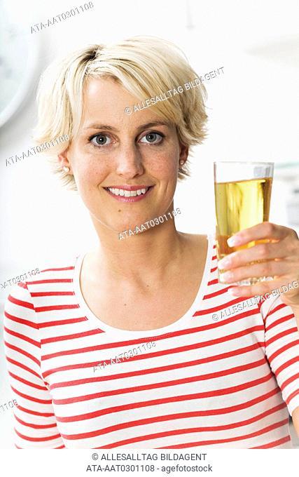 Woman drinking apple juice