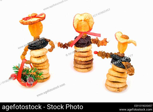 Three dried-fruit Christmas dolls
