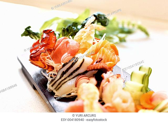 Image of delicious lunch served on wooden plate at the restaurant
