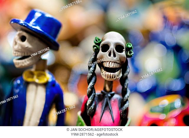 Calaca figurines are sold on the market during the Day of the Dead festival in Mexico City, Mexico, 28 October 2016. Skulls