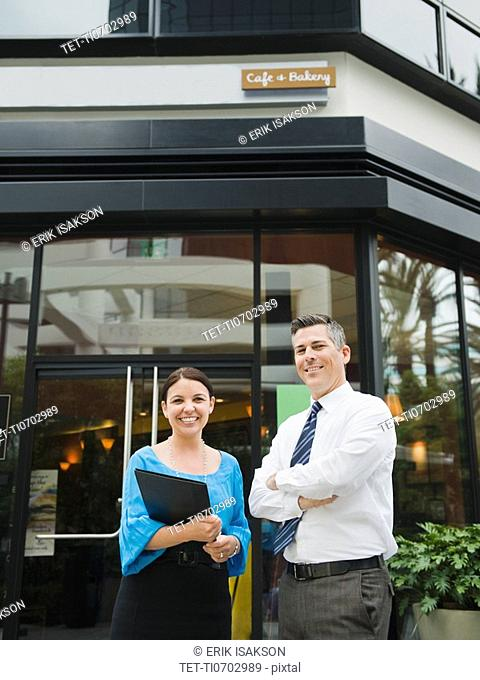 Business owners standing in front of building