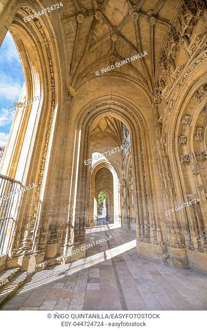 exterior portico with arches of landmark cathedral of San Salvador, gothic monument from thirteenth century, in Oviedo city, Asturias, Spain, Europe