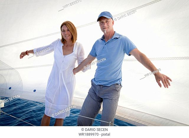 Mature couple on sailboat, having fun, Adriatic Sea, Croatia