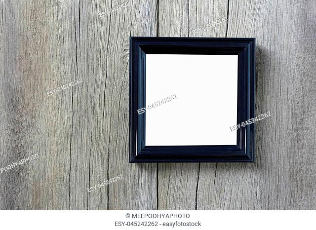 Modern Picture Frame on wooden wall and have copyspace for design in your work