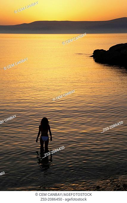 Woman in the sea, Koufonissi, Cyclades Islands, Greek Islands, Greece, Europe