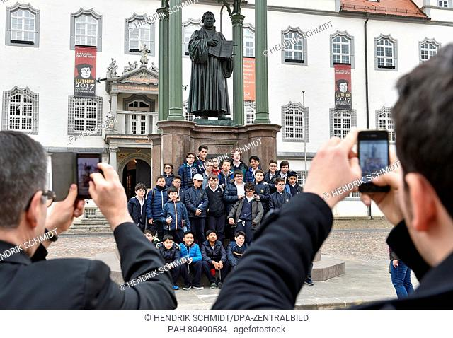 The boys of the Sistine Chapel Choirpose for a group picture at the Martin Luther memorial on a tour throughWittenberg, Germany, 18 May 2016
