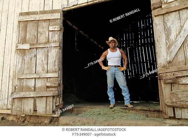 Rancher standing at doorway of barn. Poway, California. USA
