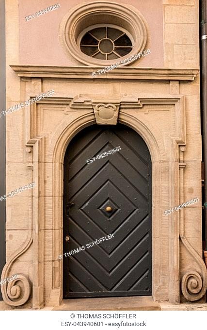Old door of a historical building with stairway