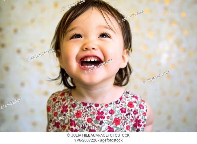 16 months old smiling baby girl