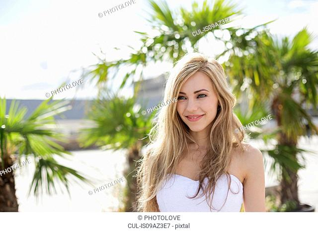 Beautiful long blond haired young woman in city